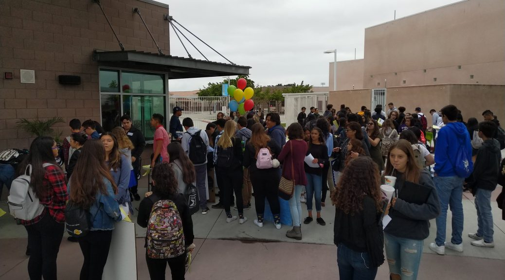 Photo shows students gathered out front of San Ysidro High School as they check in for the student conference.