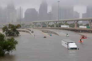 Scene showing freeways flooded and vehicles stranded, near downtown Houston.
